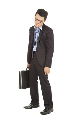 negativity: overwork and exhausted businessman holding briefcase
