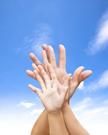 family united hands with blue sky and cloud  photo