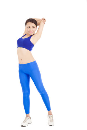 smiling Asian woman stretching her arm and smiling 版權商用圖片