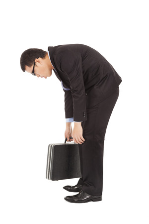 frowzy: listless businessman stoop and holding briefcase Stock Photo