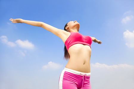 sports woman opening arms  to relax body photo