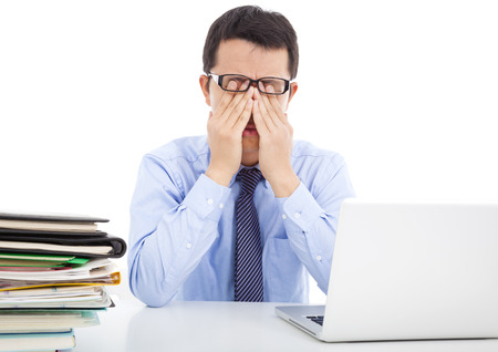 weary:  businessman is too fatigued to rubbing his eyes Stock Photo