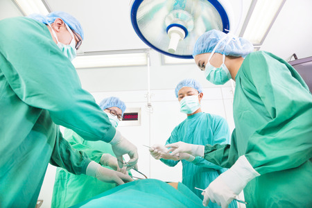 Team surgeon  working in operating room. photo