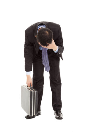 tired businessman: afflictive businessman stoop and hold his head