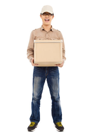 consign: full of delivery man holding parcel and standing
