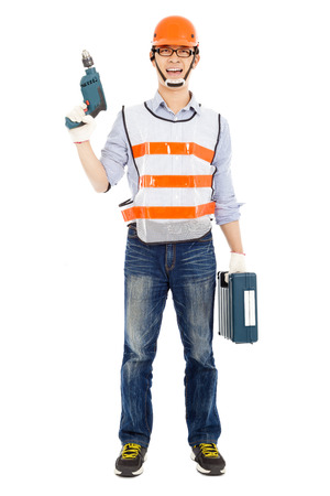 power drill: Male worker  holding  power drill and tool box  Stock Photo