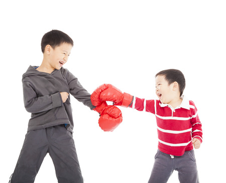 two boys fighting with boxing gloves. photo
