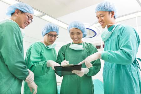 happy Surgeons discussing success operating procedure photo