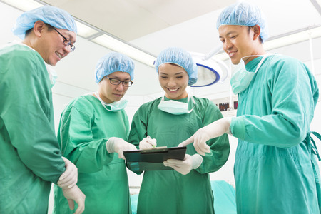 asian medical: happy Surgeons discussing success operating procedure Stock Photo