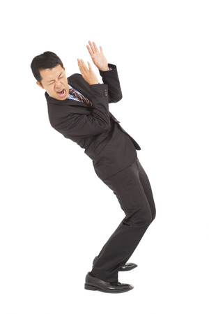 freaked: businessman scared  expression and bend down Stock Photo
