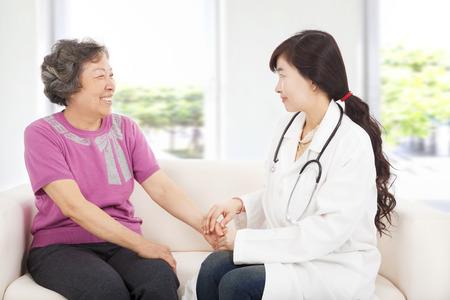 medical doctors: friendly doctor caring senior woman indoor room