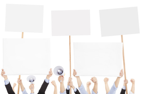protest signs: furious people protesting with board and megaphone Stock Photo