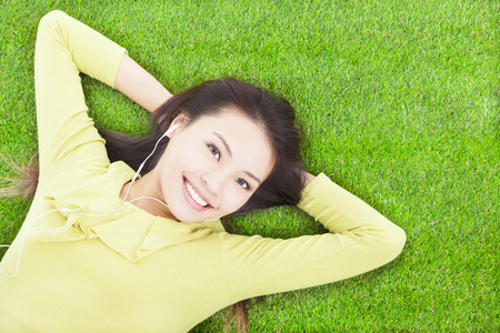beautiful  woman holding head and lying on a meadow photo