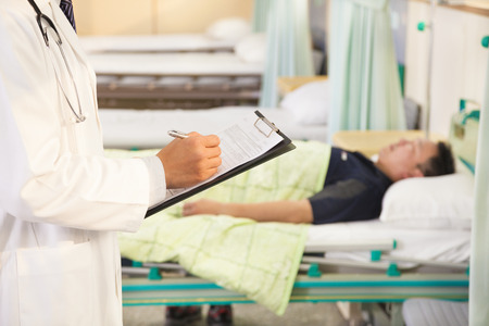 hospital background:  doctor records patients medical situation