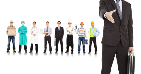 manpower: businessman cooperate with different industries people  Stock Photo