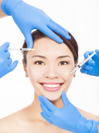Beautiful woman gets cosmetic injections in her face photo