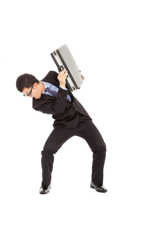 freaked: terrified businessman using briefcase to protect.