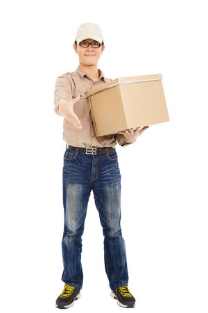 consign: smiling  delivery man holding parcel and standing