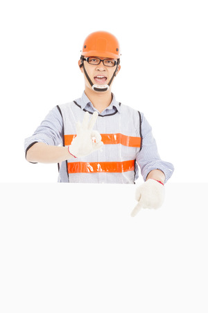 Male worker  make ok gesture with white board photo