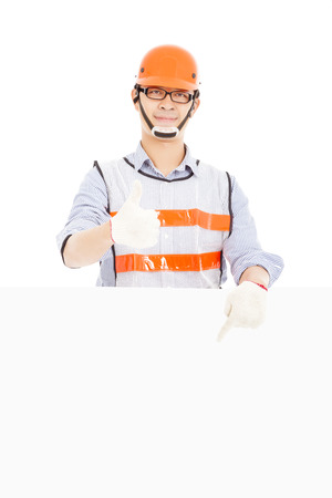Male worker  thumb up gesture and pointing to  white board photo
