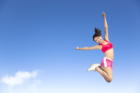 happy young woman jumping in the sky photo