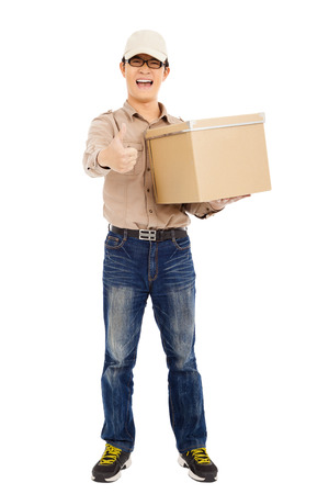 consign: smiling  delivery man holding parcel and thumb up