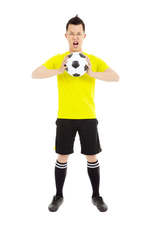 football socks: soccer player exclaimed and holding a soccer