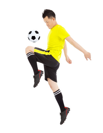 football socks: soccer player jumping to stop the ball