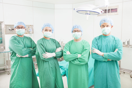 operating theater: professional surgeon teams standing in a surgical room