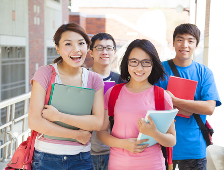 smiling students  standing together at campus Stock Photo