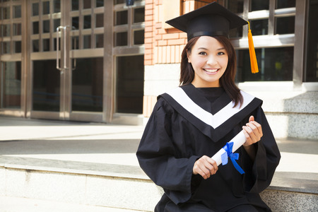 pretty college student holding a diploma at campus Stock Photo