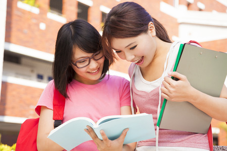 two students discuss homework  happily