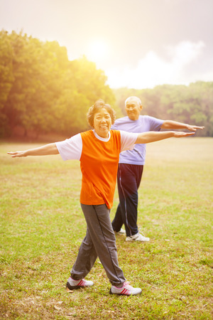senior asian: happy asian Senior couple with sunset background Stock Photo