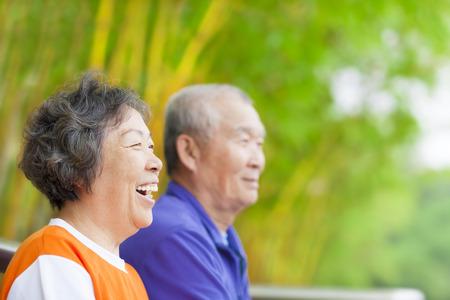 happy asian seniors in the park Stock Photo