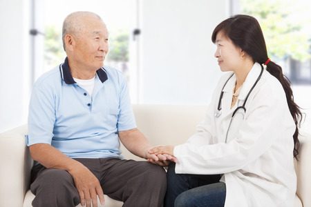seniors: friendly doctor caring senior man indoor room