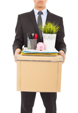 moving office: businessman felling sad and carrying his belongings Stock Photo