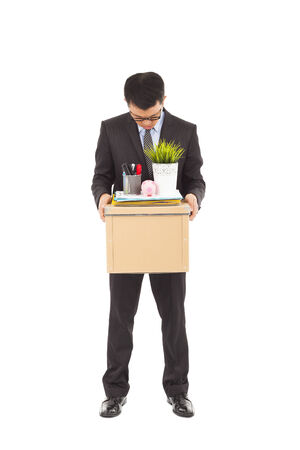 portrait of a fired businessman carrying a box photo