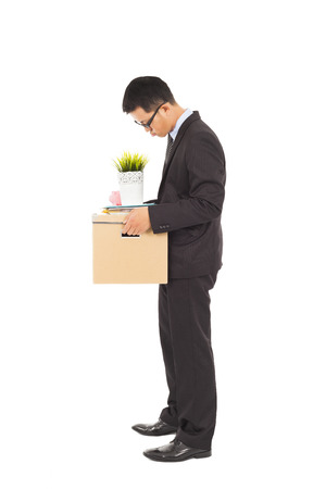 Businessman loses his job with carrying his belongings