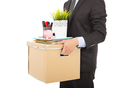 fired businessman carrying his belongings Stock Photo