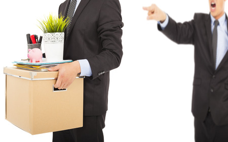 unemployed dismissed: An angry boss firing a man and carrying belongings