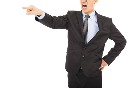 angry businessman pointing to  somthing with yelling photo