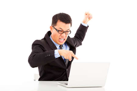 wrath:  businessman yelling and make a fist with laptop Stock Photo