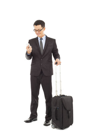 Young businessman holding a cell phone  with briefcase  photo