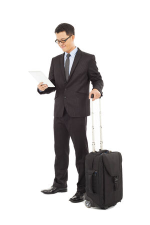 Young businessman holding a tablet  with briefcase  photo