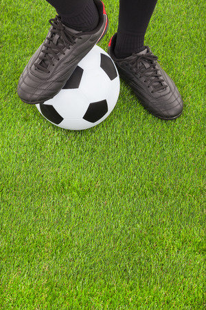 men socks: Soccer players feet  and football on field  Stock Photo