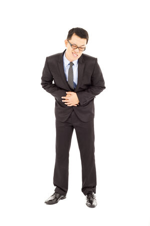 Businessman holding his stomach in pain  photo