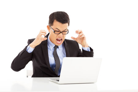 angry businessman: crazy businessman feeling angry Stock Photo