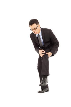 businessman having  the knee pain Stock Photo