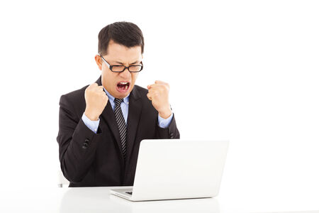 wrath: wrath businessman make a fist and yelling Stock Photo