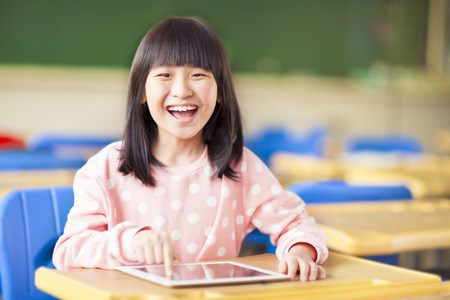 happy little girl using tablet  Stock Photo
